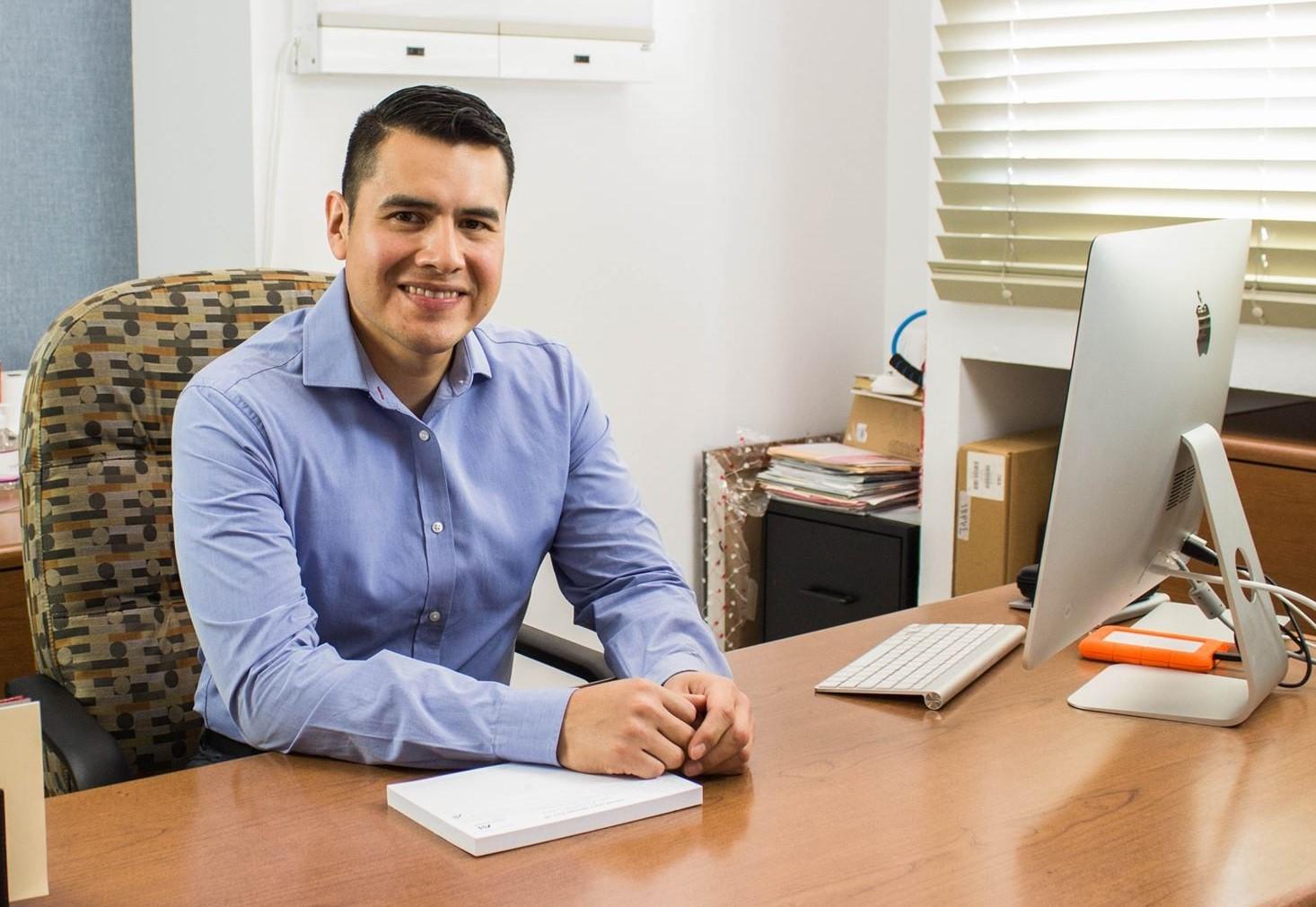dr. luis santos at desk